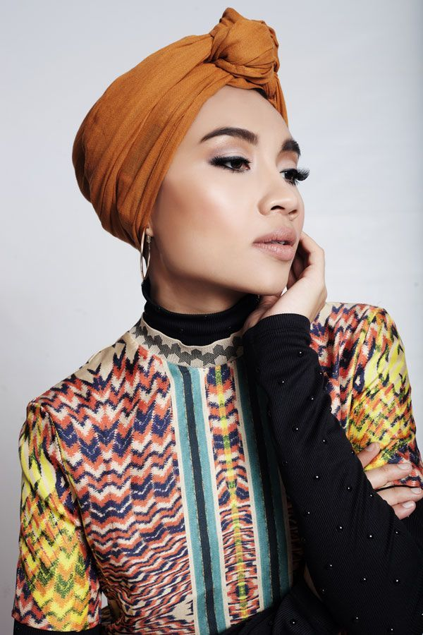 Hijab Fashion of Yuna, an international singer from ...