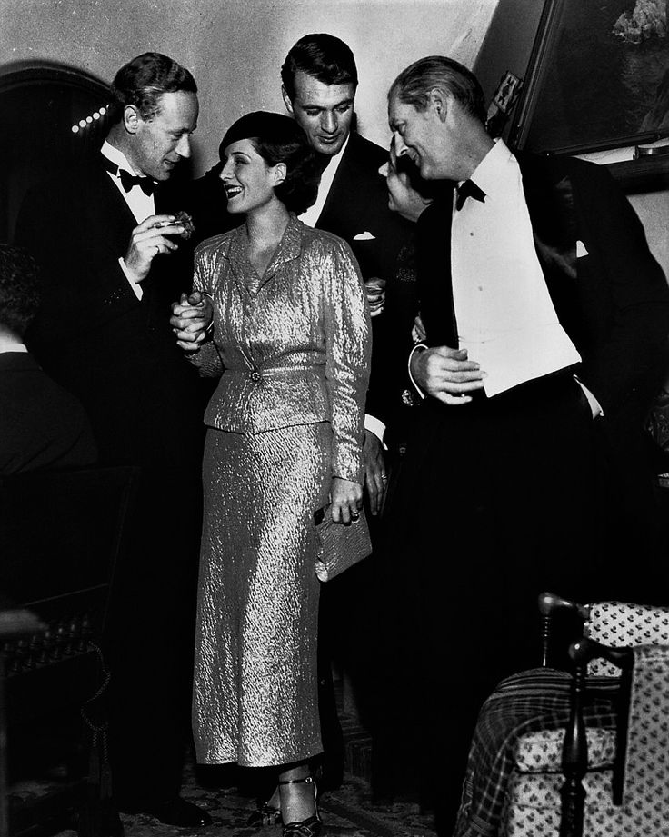 L for legends: Norma Shearer, Leslie Howard, Gary Cooper & Lionel Barrymore at Gary's Christmas party