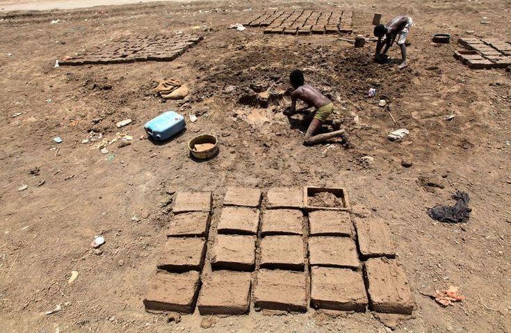 Takenin Khartoum, Sudan, on September 17, 2011. Like many people in the Darfur region, this boy makes money by forming mud blocks.