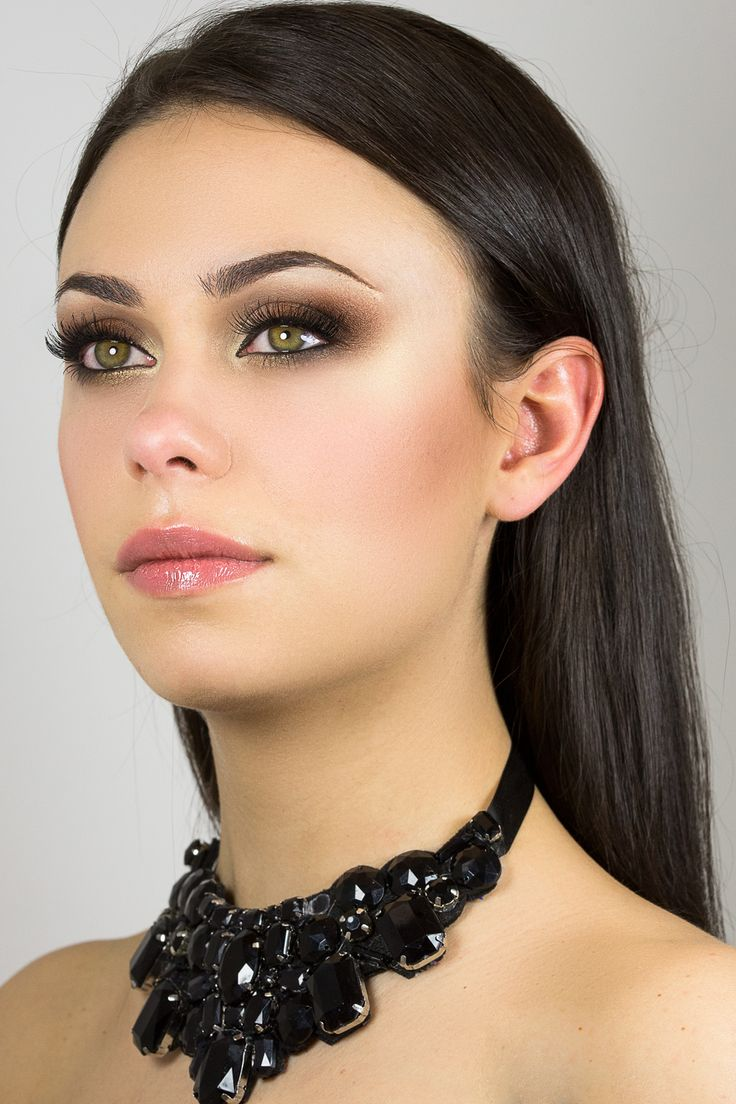 Bold smokey eyes using neutral shades and glossy lips.