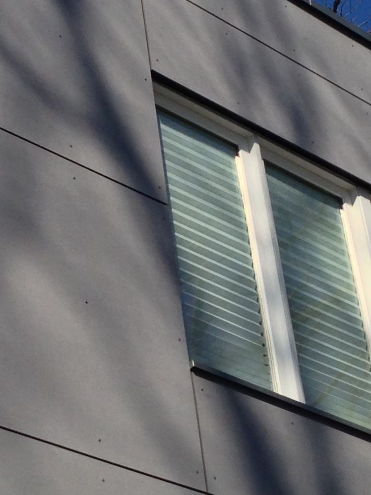 Ventilated Window sill, side closure and head up close. Etercolor High Density Fiber Cement Rainscreen System with .050 Kynar painted aluminum coping system and entry canopy cladding by GFS Architecture by Becker Architects Ltd