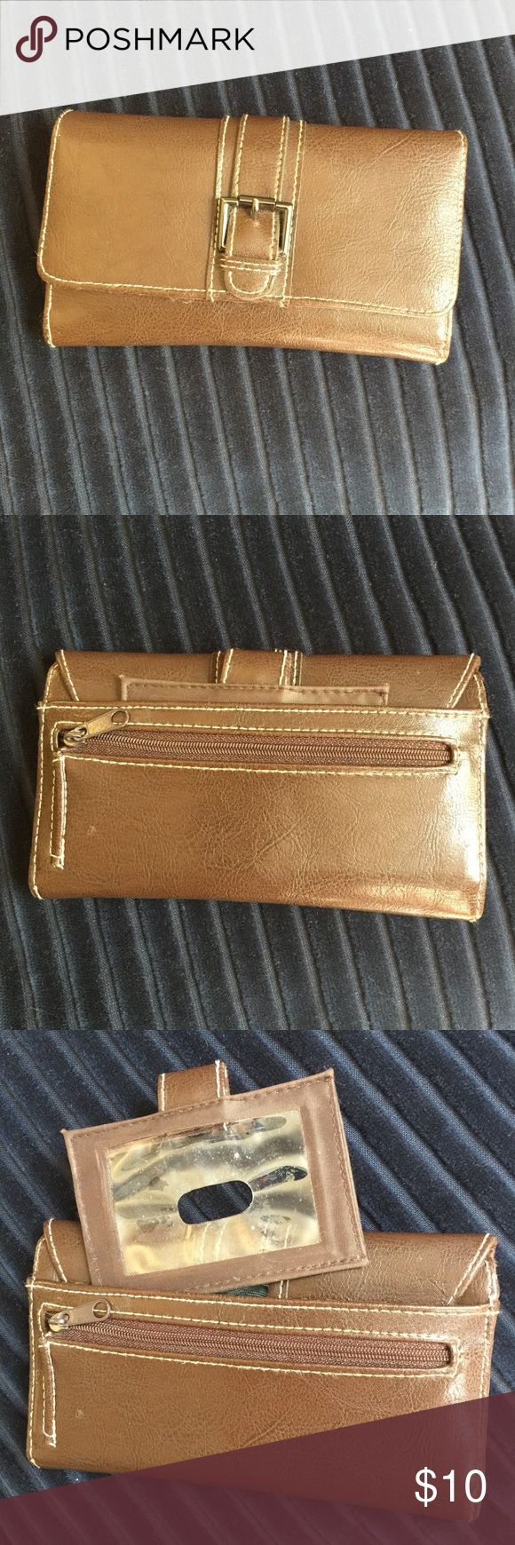"NWOT Brown trifold wallet. Closed 7""x4"" open 10.5"" Trifold wallet. Brown. Snap closure. Trifold. Pockets for pen, credit cards, checks. Separate pullout holder for ID. NWOT. All orders are shipped same or next business day. Bundle to save even more money. Bags Wallets"