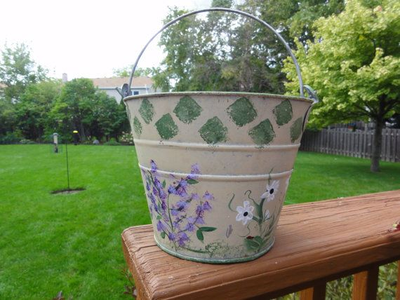 Small hand painted garden bucket . Hand painted down to the lady bugs. 8-1/2 inches across and 8 inches deep.  Great as home accent -planter or