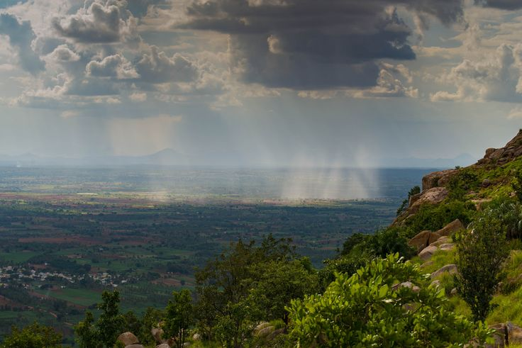 https://flic.kr/p/xoKNWa   View from Makalidurga Hill Fort   View from Makalidurga, a hill fort which is 60 kms north of Bangalore. Captured this landscape image of the cloud formation and the rain, in the nearby Doddaballapura village. www.ravindrajoisa.com