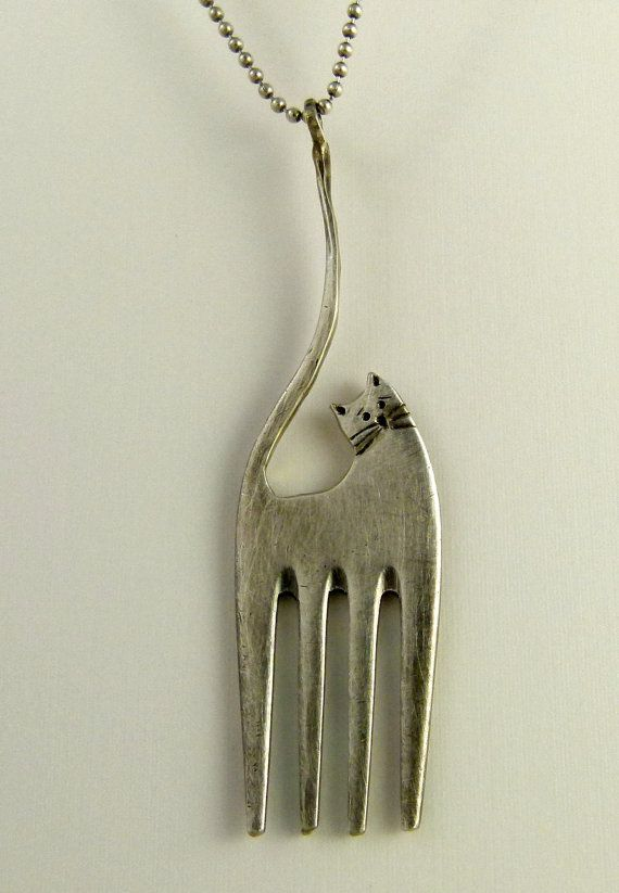Fork cat...    Up cycled sterling plated fork and up cycled sterling ... need a Dremel for this one