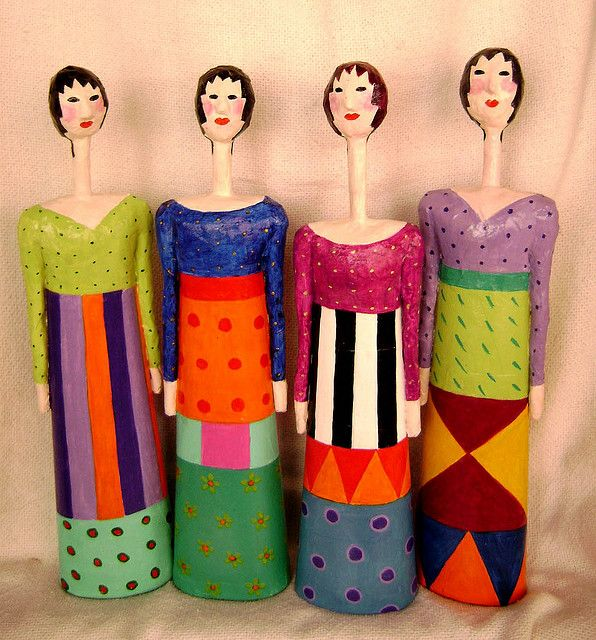 Paper Mâché. I love these, but the necks need to be shorter, their kinda creeping me out.