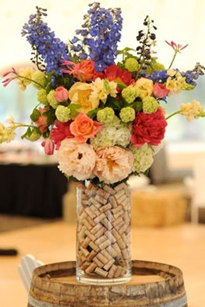 Add some creativity to a centerpiece by adding some wine corks in the vase~ you could spray paint the corks silver or gold for a wedding or the winter holidays!