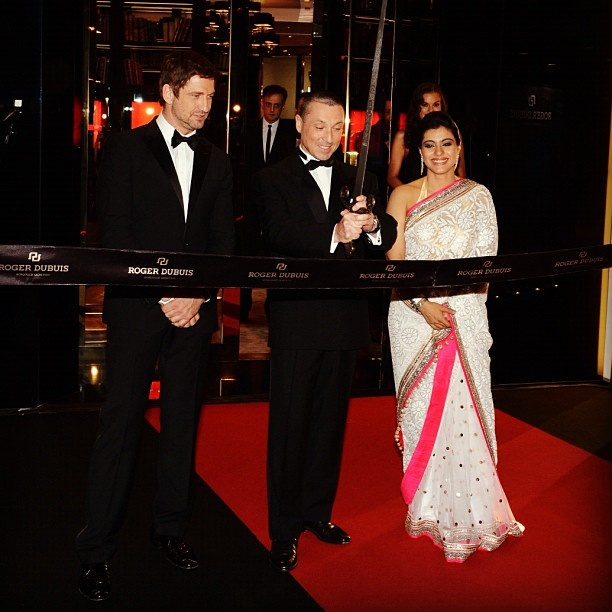 Jean-Marc Pontroué, CEO of Roger Dubuis, for the ribbon cutting ceremony, with Gerard Butler and Kajol.