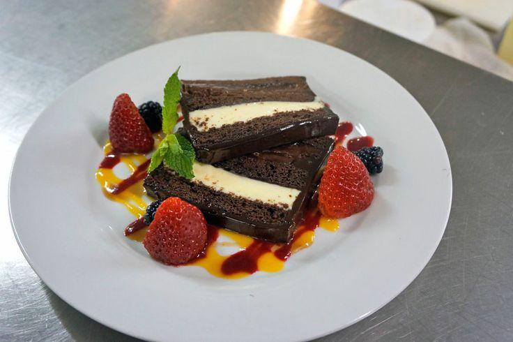 Ohhhh myyyyy  CHOCOLATE QUAD CAKE, CHOCOLATE CAKE LAYERED WITH BELGIAN WHITE & DARK CHOCOLATE MOUSSE, RASPBERRY COVENTURE ENCASED IN GANACHE WITH RASPBERRY & MANGO COULIS, FRESH BERRIES  Lambert's Cove Inn & Restaurant, Martha's Vineyard Island, MA