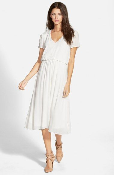 the perfect spring or easter dress. White dress or in tangerine for $68! Wayf Blouson Midi Dress