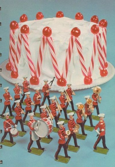 Marching Band Cake, with peppermint sticks, cherries, and your own personal little band of little men playing musical instruments. How festive can you get?