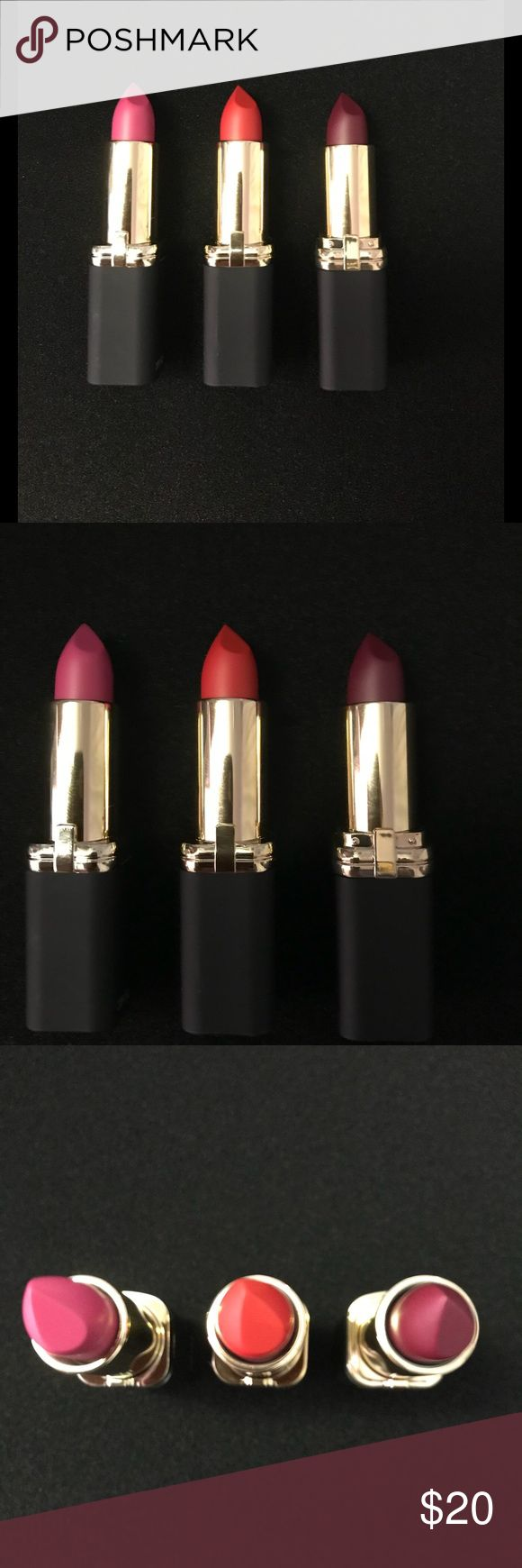 Set of 3 L'Oreal matte lipsticks Set of 3 L'Oreal matte lipsticks  Jennifer's pink (705) limited edition for J Lo deep plum Matte Mandate (712) deep magenta Matte-ly in Love (102) classic red  Brand new Never used, swatched or opened other than for photos l'oreal Makeup Lipstick