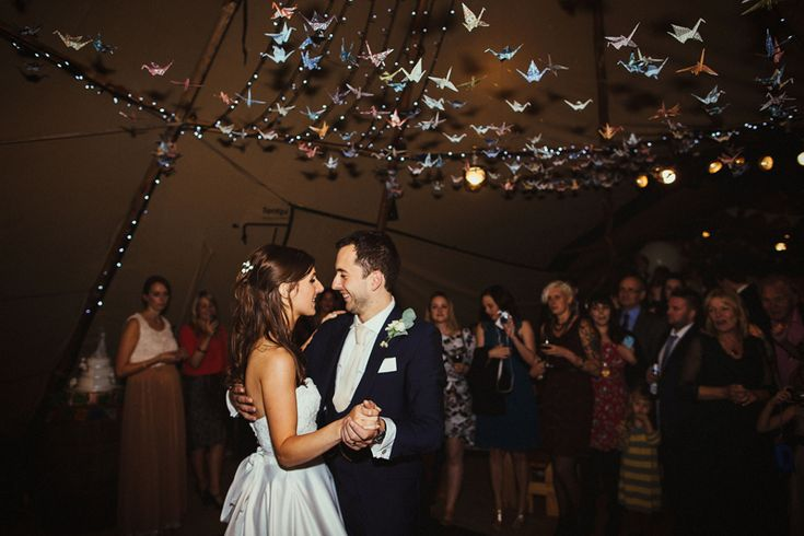 Image By Claudia Rose Carter - A Rustic DIY Wedding In Hitchin Hertfordshire With Bride In Paloma Blanca Gown And Groom In Royal Blue Bespoke Suit From Jack Bunneys With Tipi From The Stunning Tents Company And A Handcrafter Perspex Cake Topper