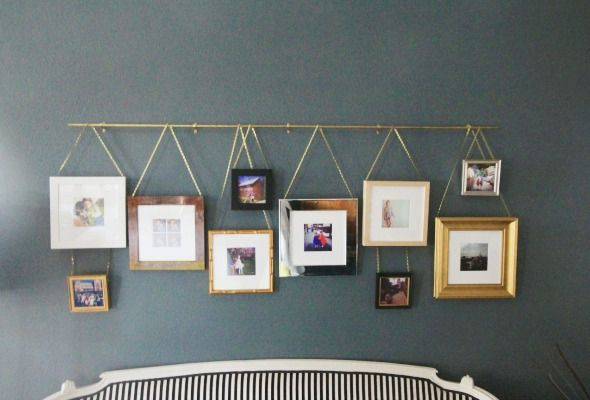 Brass beauty:  simple brass rod, plumbers chain, cup hooks screwed into gorgeous frames http://littlegreennotebook.com/2014/10/affordable-framing-and-easy-diy-picture.html