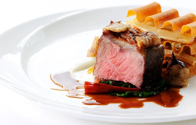 Roasted sirloin of beef with a bone marrow sauce, salsify, mushrooms and red wine shallots.
