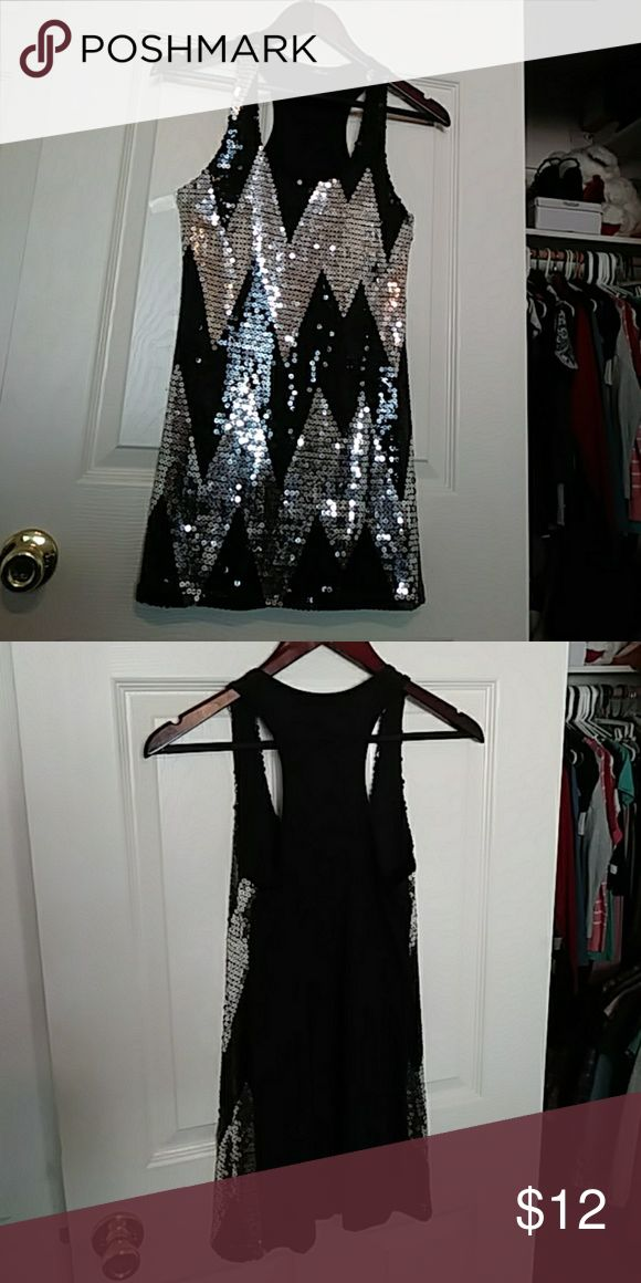 Racerback Sequin mini dress/top worn once! Black and silver dress. Front is full of sequins. Chevron pattern short dress or can be worn as a top. In great condition! Bloom Dresses Mini