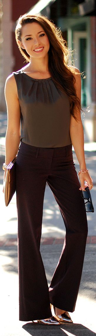 Sleeveless blouse tucked into slacks. Add a cardigan Great work outfit. Love the metallic shoe