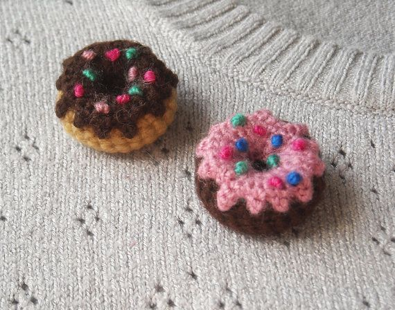Donut Brooch  Crocheted with wool and acrylic yarn. Small pin on the back. Diameter: About 1 (2.6 cm).  The listed price is for ONE brooch but you can