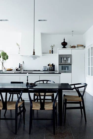 white white kitchen with white hood,dark floors and furniture......