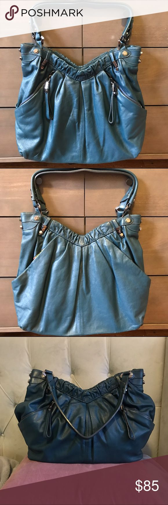 Oryany Teal Leather Bag Like new! Beautiful deep teal color. Nice size, pretty large. Very Slight sign of wear near the bottom. ORYANY Bags Hobos