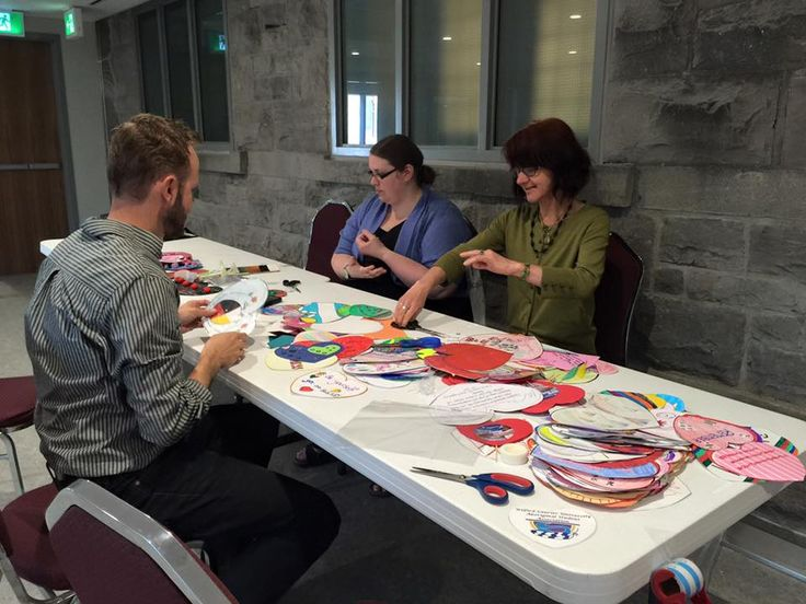 KAIROS staff and volunteers, do the last minute preparations for getting the hearts ready for planting. Hearts created by children from across Canada - honouring the children lost to the Indian Residential School system and marking new possibilities in reconciliation.