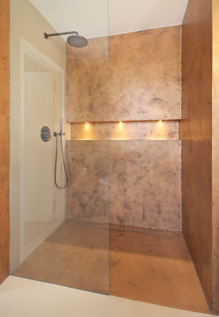 Bathroom in copper design - detail with lid storage space.