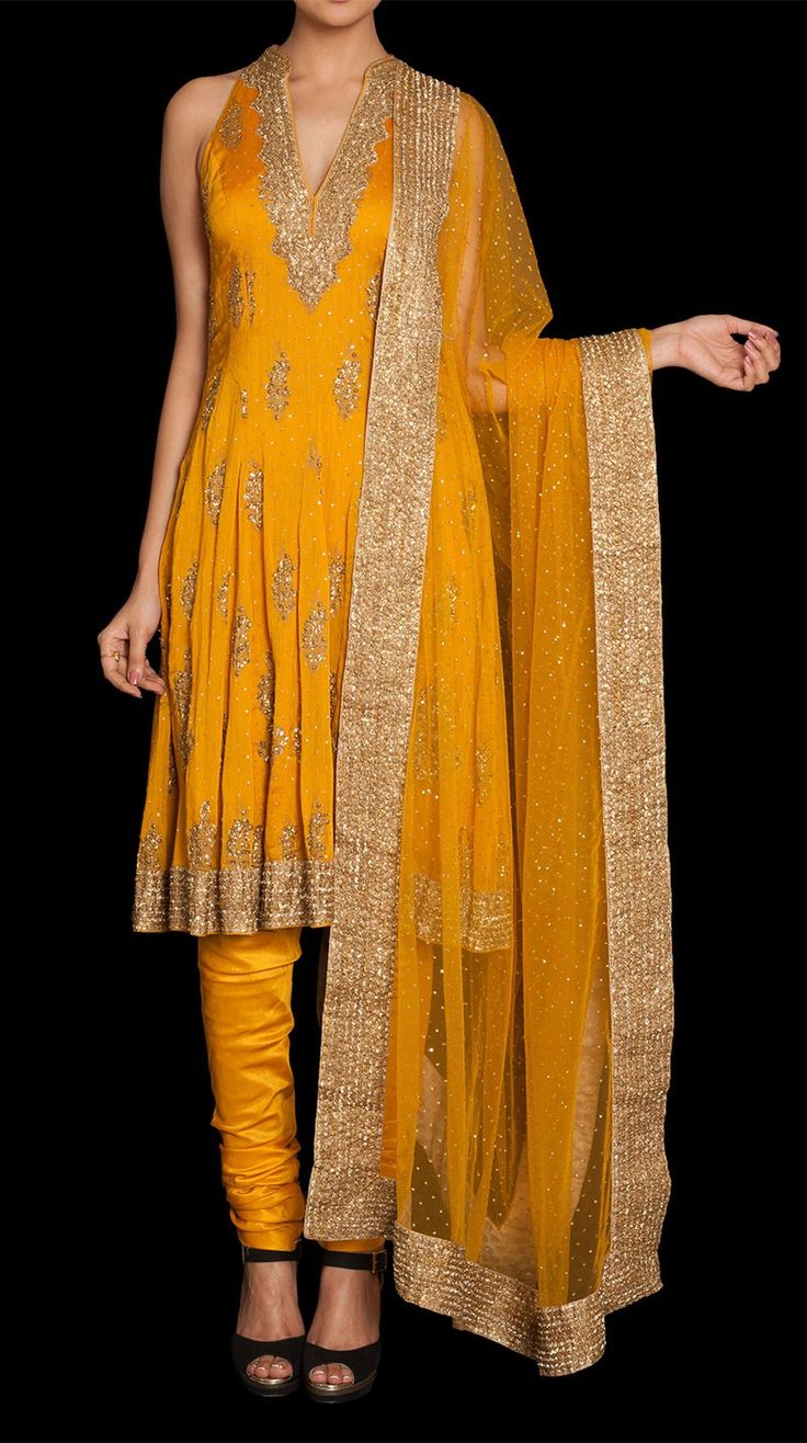 A sleeveless chanderi silk suit with a slightly flared kurta and a matching churidar and net dupatta. http://www.ritukumar.com/a-suit-from-phool-range-by-ritu-kumar-with-yellow-color