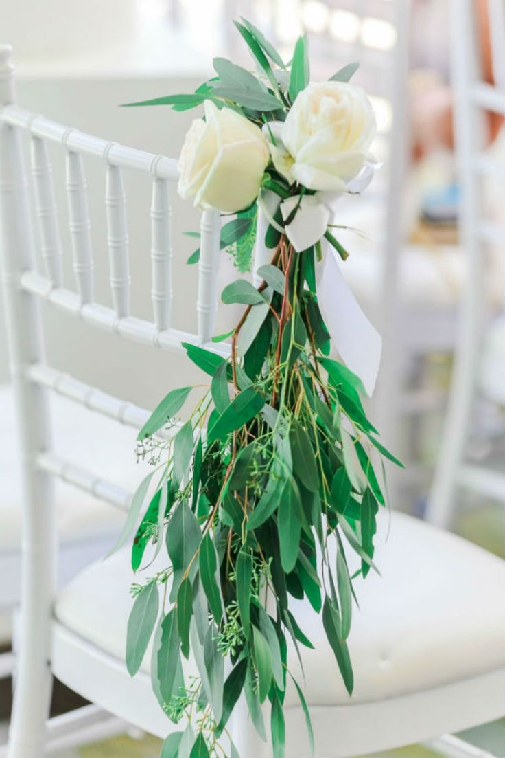 Beautiful flowers used for chair decor (Scribbled Moments Photography, Inc.)