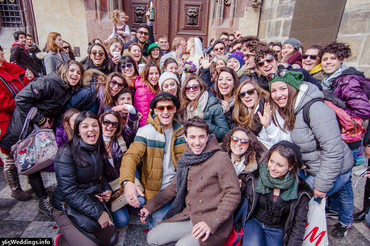 Group portrait at the wedding in Prague. Old town square — lovely Italians! http://365weddings.info/love-story-in-prague/