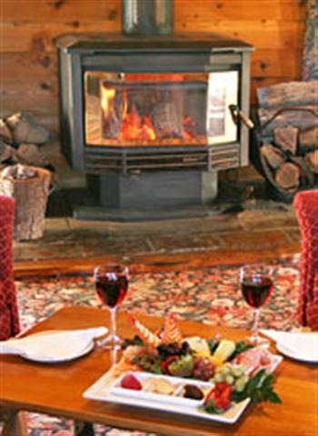 Glass of Wine with a cheese plate relaxed in front of the log fire at Cradle Chalet Boutique Luxury Lodge Tasmania