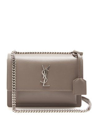 eee8cc4e68 Saint Laurent s signature silver-tone metal YSL plaque perfectly accents  this versatile taupe-grey Sunset bag. It s made in Italy from lightly-…