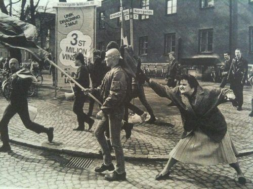 A woman hitting a neo-nazi with her handbag, Sweden, 1985. The woman was reportedly a concentration camp survivor.