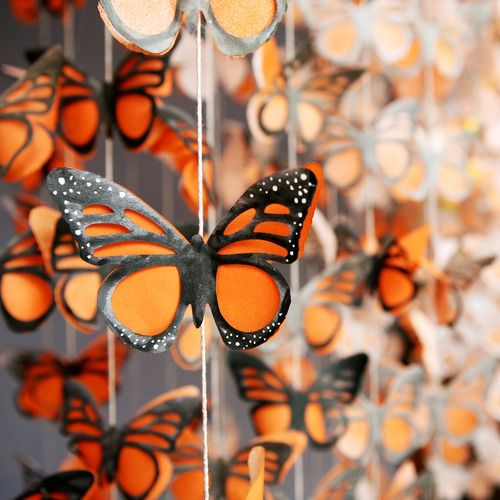 making paper monarch butterflies like this would be pretty easy... this is just a photo for inspiration, not a how-to.