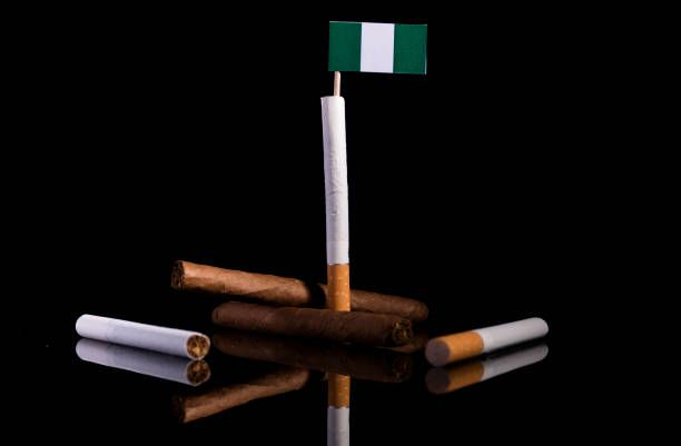 nigerian flag with cigarettes and cigars tobacco industry concept