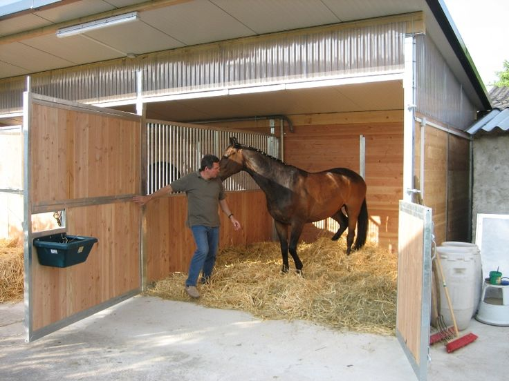 Horse stable with fully opening wall and door.