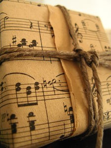cute wrapping idea. Do with Christmas music and twine. *happy birthday tune for birthdays?