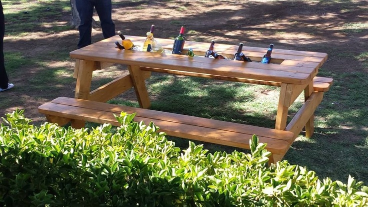 Picnic table with cooler trough awesome outside for Table with cooler in middle