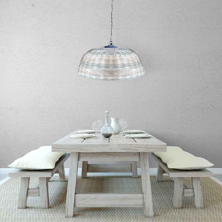 The multi-tonal rattan pendant light is the perfect statement piece for above dining tables