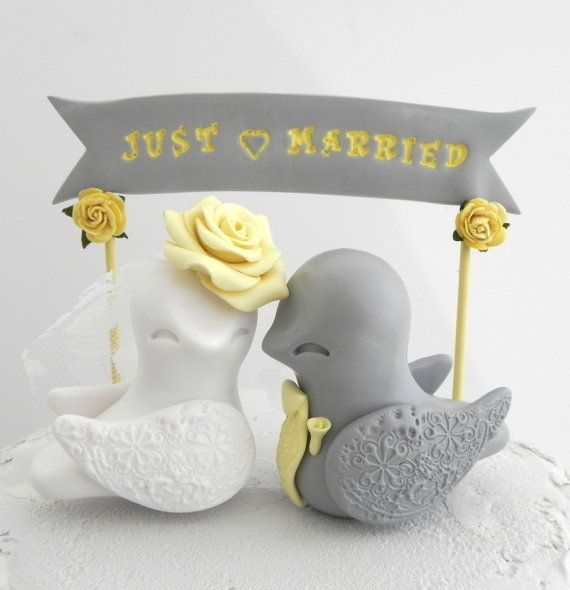 These beautiful grey and yellow lovebirds will add the perfect touch to your beautiful cake. The sweet little banner can be customized to say your names, your date or a sweet phrase. The bride has a yellow rose, with a birdcage veil and the groom has a yellow bow-tie.