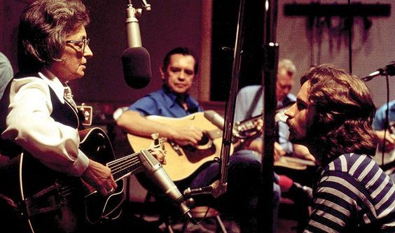 Mother Maybelle Carter, Merle Travis, Oswald Kirby, and Jeff Hanna of the Nitty Gritty Dirt Band. Photo taken during the Will the Circle Be Unbroken sessions in August 1971 at Woodland Studios in Nashville. (photo by William E. McEuen)