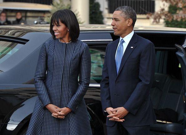 Michelle Obama wearing Thom Browne navy jacquard coat. #Inauguration