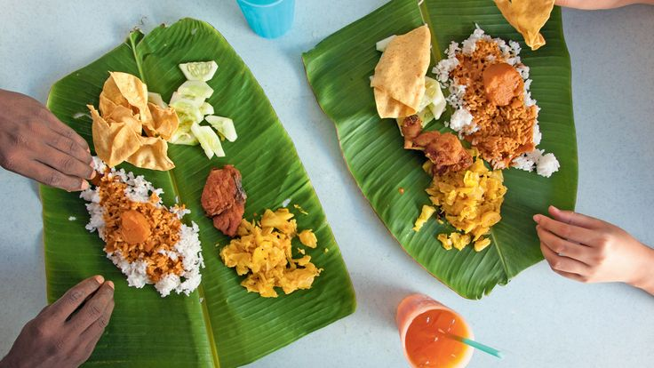 Eating with your hands from a banana leaf