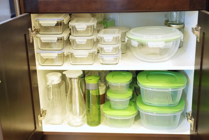 My Tupperware cupboard was always in disarray. We had 5 different types of containers, none of which stacked up nicely together. We finally invested in the same glass containers and now they stack up easily, no more hunting for a lid.  http://www.11magnolialane.com/category/home-inspiration/page/4/