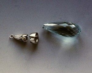 Platinum restoration Of Aquamarine  briolette