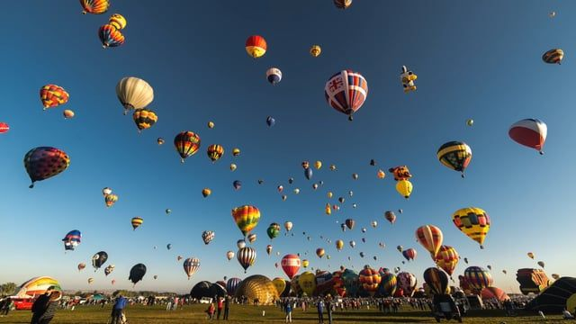 """A time lapse film capturing """"mass ascension"""" during the 2015 Albuquerque International Balloon Fiesta.  This time lapse film was captured on Saturday October 8th, 2015.  In my opinion, this day ended up being the best day for flying all week.  The video beautifully illustrates the """"Albuquerque Box."""" The box is a common weather feature that allows balloons to travel in all directions by changing their altitude.  This feature allowed pilots to take off and fly for over an hour and find winds…"""