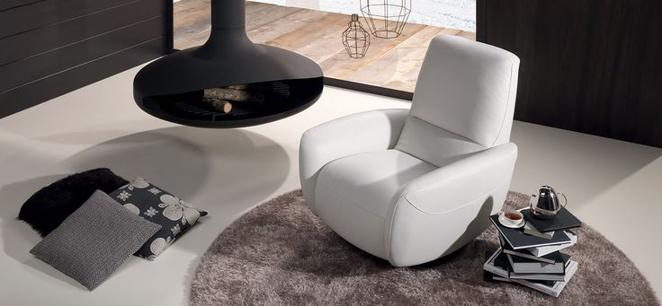 NATUZZI – GENNY Perfect for decorating any area of your home, the fresh, cozy design of the Genny armchair features a soft rounded seat supported by a swivel metal base. #ItalianDesignerFurniture #LuxuryItalianArmchairs @Natuzzi