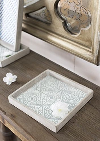 NEW in - This stunning tray set has an inviting look and stunning pattern. Use as a serving tray for a Moroccan afternoon tea or simply display as striking visual pieces around your home for a touch of the exotic.