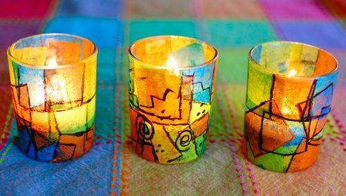 Candle Holders - Frank Lloyd Wright style - cut up pieces of colorful tissue paper into 1 inch squares, attached them to the outside of the votive using Elmer's glue and a paint brush, Once the glue had completely dried, add details with a black permanent marker to outline the squares.