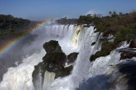 IGUAZU NATIONAL PARK (BORDER OF BRAZIL AND ARGENTINA)  Iguazu National Park is located on the border between Brazil and Argentina, where the Iguazu River breaks into majestic cascades and mists the surrounding forest life.