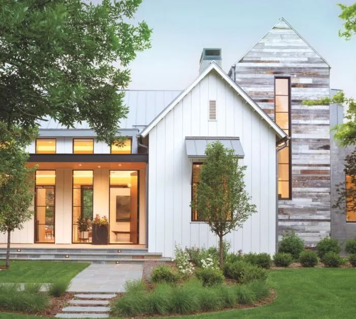 This Denver home is modeled after rural and modern influences that emphasize farmhouse glam. Take a look at the exterior with simple landscaping to welcome guests.